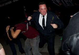 us police beaten demonstrators in wall street
