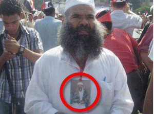 A brotherhood thug on the 17th of August carrying Bin Laden Picture, those are the brotherhood USA are supporting