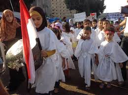 children forced to wear shrouds and kept in Rabaa square armed sit-in