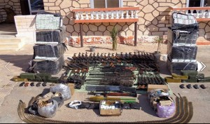 28 July 2013 Military arrested smugglers of different rifles and snipers rifles and bullets and drugs in cooperation with the Egyptian Marine in the west military area thru the sea by Saloum City