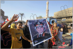 Egyptians in kirdassa area are raising AlSisi Minister of Defence image