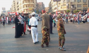 Egyptian Children wearing police and military uniforms celebrating 6 october war victory