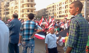 Egyptians carrying the Egyptian flag