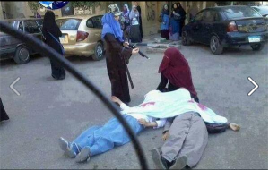 Sisterhood in Egypt faking death scene with fake blood colors that was faked and published by Aljazeera Qatarian Media News