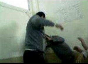 Brotherhood teacher torture a student because he wanted to play a national song while students salute the flag