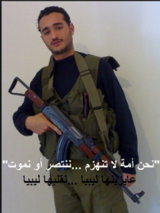 Ahmed Doma political activist carrying a machine gun during the 25Jan 2011 when he declared publically that him and other activists will turn Egypt to another libya