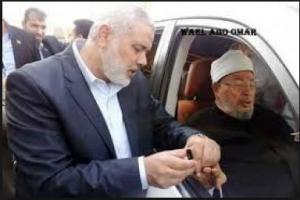 Islami Haneya Hamas terrorist Organization leader cutting the nails of Qaradawi