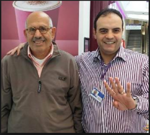 Mohamed El Baradei with a muslim brotherhood restaurant owner in london raising 4 fingers of Rabaa armed sit in
